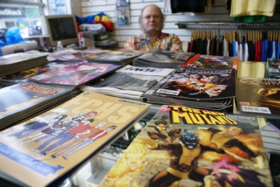 Gordo, an employee at Hi De Ho Comics in Santa Monica, makes sure complimentary comic books are well stocked for Free Comic Book Day.